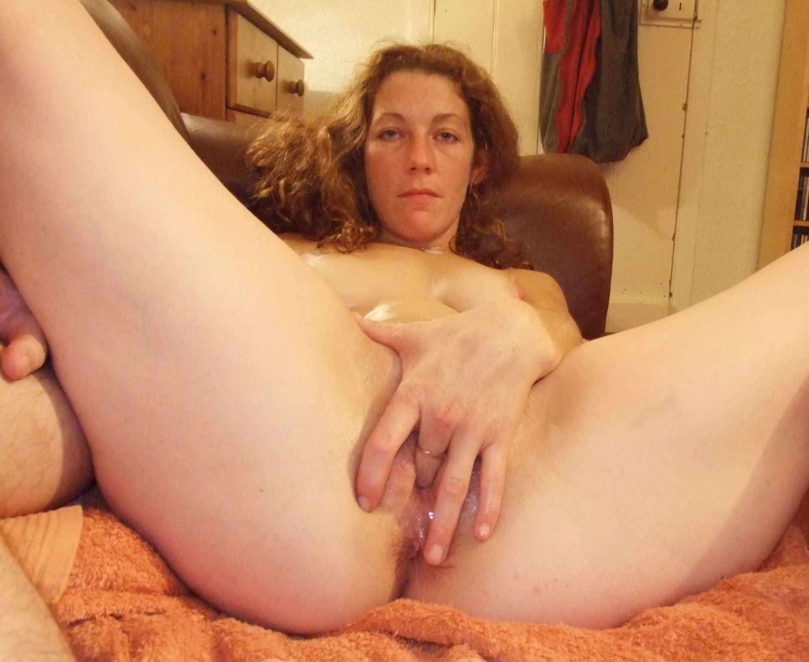 Licking oiled grannies strapon