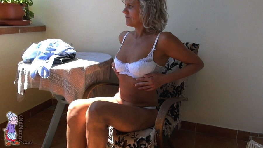Mature masturbating on the balcony