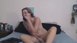 Dildo - nerdy girl in glasses riding on toy