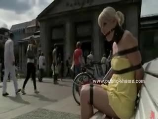 - Blonde sits outdoor on a bench tied with leather...