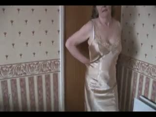 Mature - Hairy granny in slip and stockings with see thru...