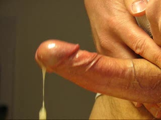 Closeup of juicy cumshot. Spritzing