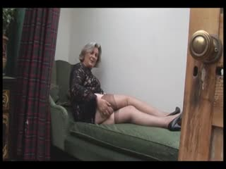Mature - Busty granny in stockings shows off hairy pussy