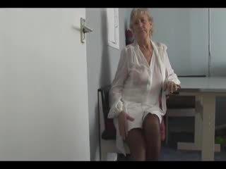Mature - Attractive Granny in short skirt panty teases sh...