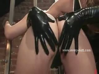 Submissive woman with latex lingerie gets ***** and fucked by her lesbian partner